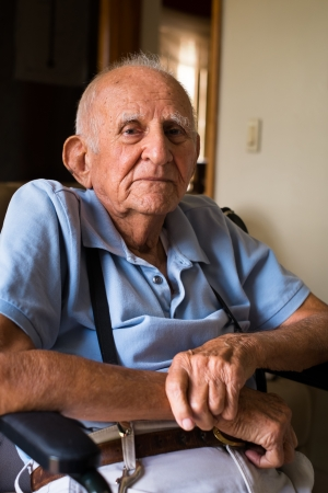 the elderly residence: old man on the wheelchair in a home setting  Stock Photo