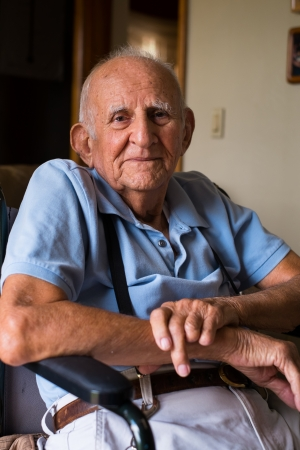 80 year old: old man on the wheelchair in a home setting  Stock Photo