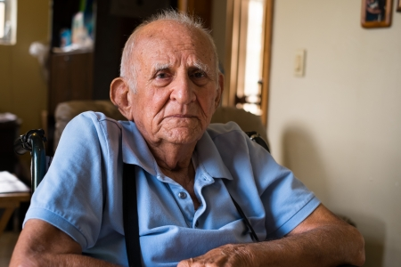 octogenarian: old man in a home setting