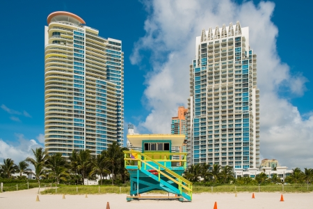 South Beach lifeguard station in Miami Beach with tall condos in the background  photo
