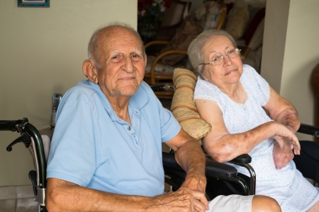 head home: Elderly handicapped senior couple in a home setting