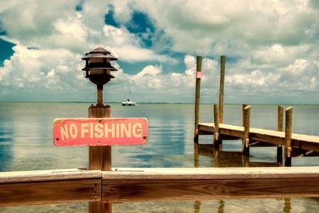 No fishing sign at a small dock along the Florida Keys  photo