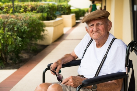 Elderly 80 plus year old man in a wheel chair outdoors  photo