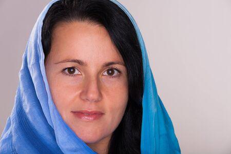 arabic woman: Beautiful eastern european woman wearing a shawl.