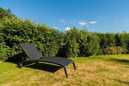 back yard: Wicker lawn chairs in a back yard residence  Stock Photo