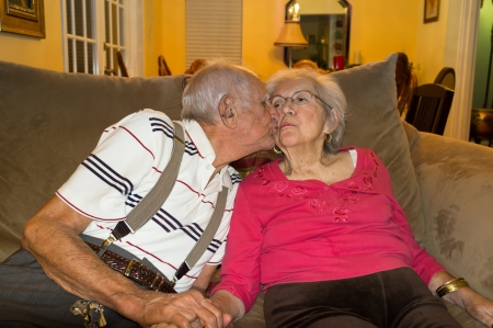 Elderly 80 plus year old couple in an affectionate pose  photo