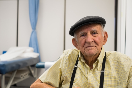 Elderly 80 plus year old man receiving physical therapy  photo