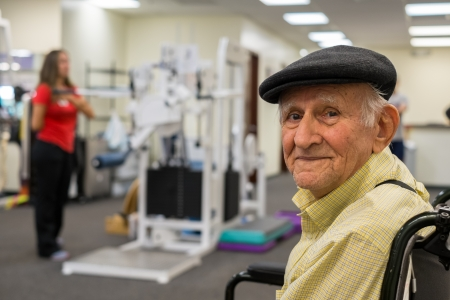 physical therapy: Elderly 80 plus year old man receiving physical therapy