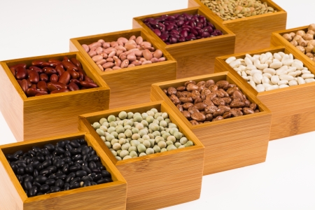 contained: Collection of various beans contained in wood boxes on a white background  Stock Photo