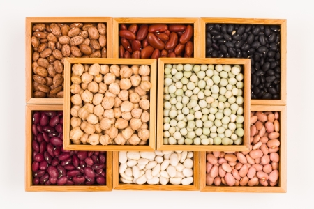earthly: Collection of various beans contained in wood boxes on a white background  Stock Photo