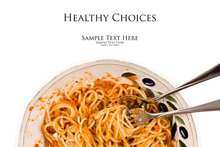 Close up view of a bowl of freshly cooked spaghetti pasta with a tomato cream sauce on a white background  photo