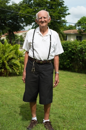 Elderly 80 plus year old man outdoors in a home setting