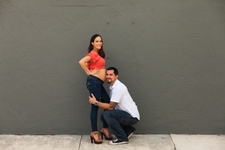 Young pregnant couple in a loving pose  photo