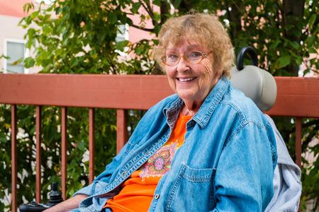 Pretty senior handicap woman outdoor portrait. 版權商用圖片