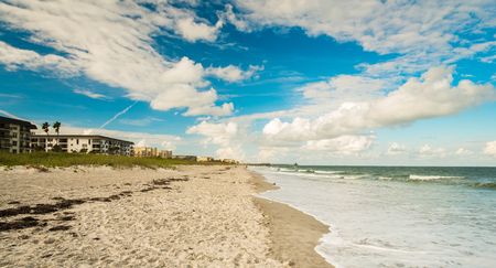 Beautiful Cocoa Beach, Florida with blue sky and clouds.