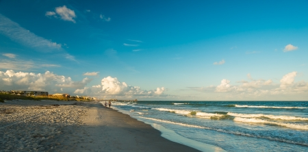 Beautiful Cocoa Beach, Florida with blue sky and clouds. photo