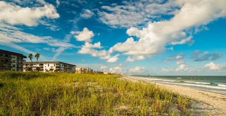 cocoa beach: Beautiful Cocoa Beach, Florida with blue sky and clouds.