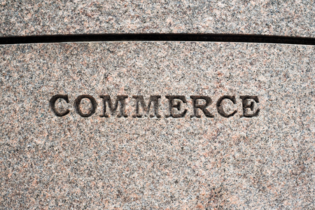 commerce: Commerce sign etched in granite. Stock Photo