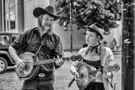 ASHEVILLE, NORTH CAROLINA OCTOBER 12  Unidentified street performers playing bluegrass style music with banjo and mandolin in downtown Asheville on October 12, 2013
