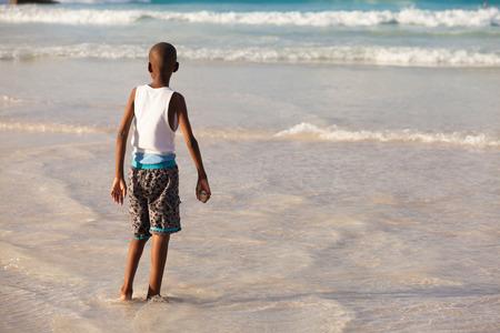 barbadian: Young boy enjoying the beauty of a Barbados beach.