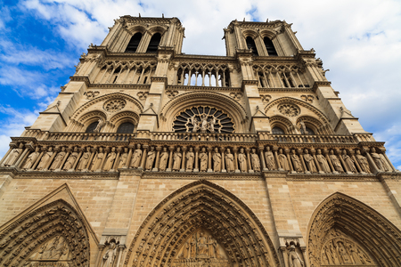 cleric: Close up view of the historic Notre Dame Cathedral in Paris, France.