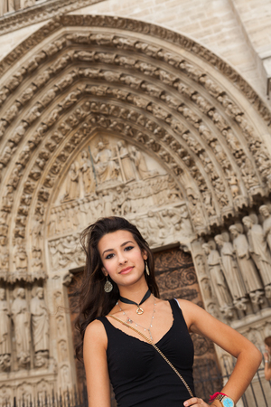 Beautiful young woman at the Notre Dame Cathedral in Paris, France  Stok Fotoğraf