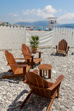 azur: Lounge chairs along the shoreline in Nice in the French Riviera  Stock Photo