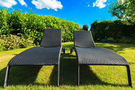 reclining lawn chair: Wicker lawn chairs in a back yard residence Stock  Photo - Reclining Lawn Chair Stock Photos Images. Royalty Free Reclining