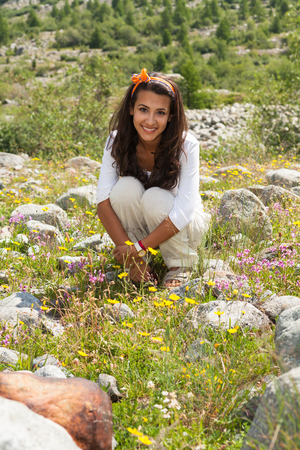 Beautiful young lady enjoying the beauty of the Swiss mountains.