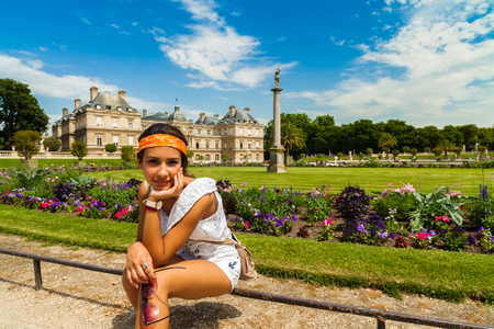 pretty young woman: Pretty young woman enjoying historic Luxembourg Gardens in Paris, France.