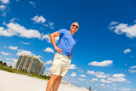 50s adult: Handsome middle age man enjoying Miami Beach.