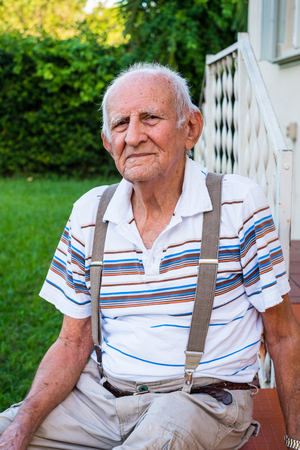 the elderly residence: Elderly eighty plus year old man outdoors in a home setting.