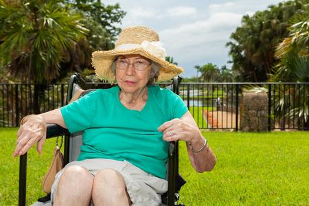 octogenarian: Elderly handicap woman outdoors in a garden setting. Stock Photo