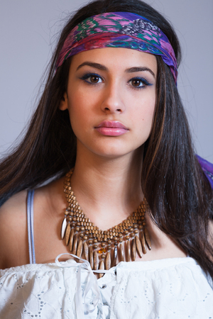Beautiful multicultural young woman studio portrait. photo