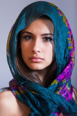bandana girl: Beautiful multicultural young woman studio portrait wearing a purple veil