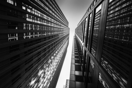 Black and white abstract upward view of downtown skyscrapers. Stock Photo