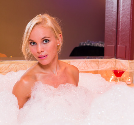 Beautiful sexy blond woman in a hot tub