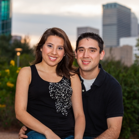 Young couple in a affectionate pose in a urban downtown park  setting at sunset. photo
