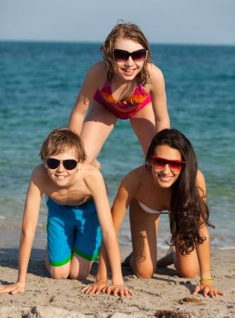 blond boy: Teenagers having fun along the shoreline in Miami Beach. Stock Photo