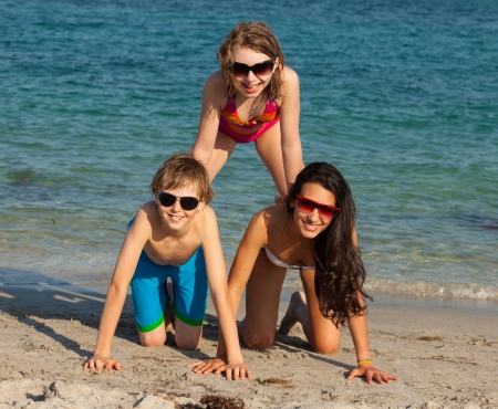 Teenagers having fun along the shoreline in Miami Beach. photo