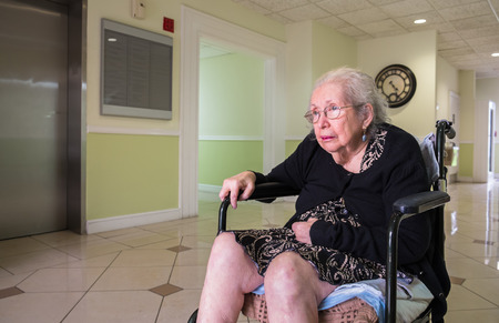 Elderly eighty plus year old handicap woman in a medical office setting. photo