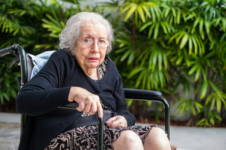 octogenarian: Elderly eighty plus year old handicap woman in a outdoor setting.