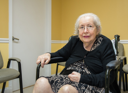 the elderly residence: Elderly eighty plus year old handicap woman in a medical office setting. Stock Photo
