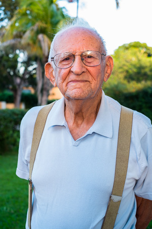 octogenarian: Elderly eighty plus year old man outdoors in a home setting.