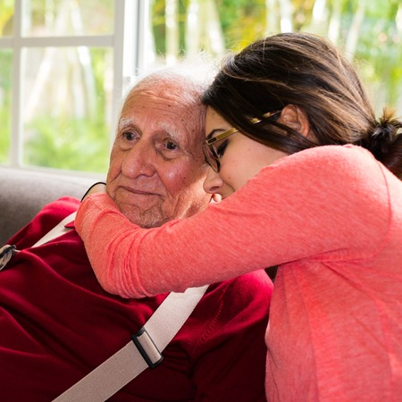alzheimers: Elderly eighty plus year old man with granddaughter in a home setting.
