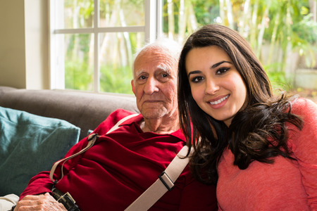 home health care: Elderly eighty plus year old man with granddaughter in a home setting.