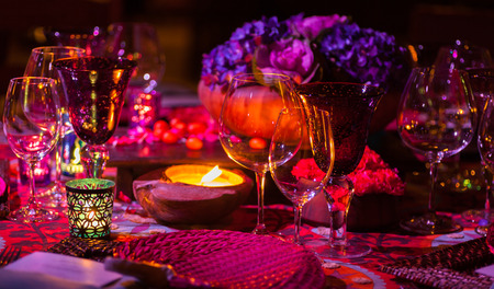 candle light dinner: Fancy dinner table setting with candle light