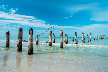 myers: Rustic decaying pier along Fort Myers Beach on the west coast of Florida. Stock Photo