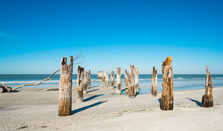 gulf of mexico: Rustic decaying pier along Fort Myers Beach on the west coast of Florida. Stock Photo