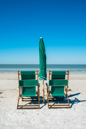 Lounge chairs along popular Fort Myers Beach on the west coast of Florida. photo